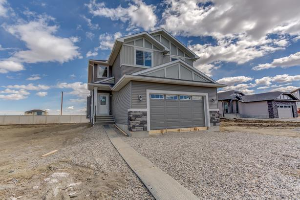 Gorgeous new home with fabulous upgrades and mountain views!
