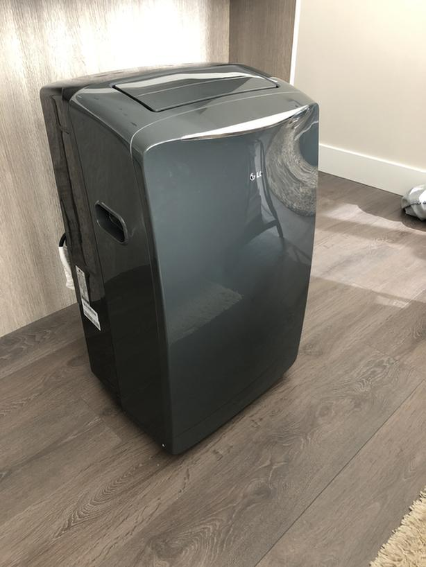  Log In needed $250 · LG 14,000 BTU Portable Air Conditioner with  Dehumidifier and Remote