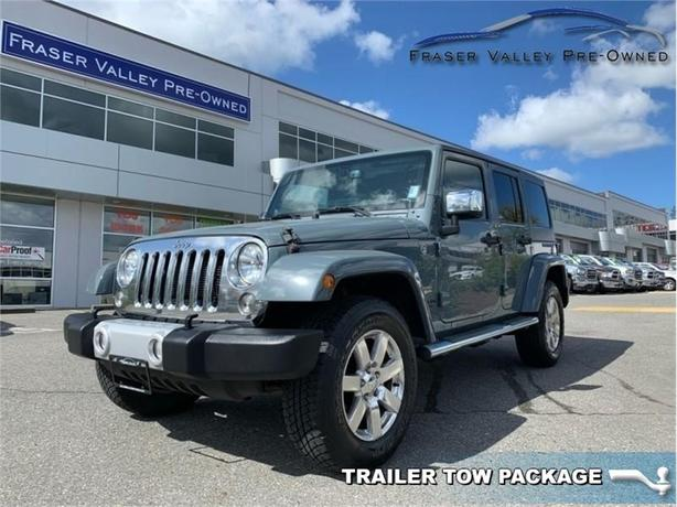 2014 Jeep Wrangler Unlimited SAHARA  -  - Air - $229.11 B/W