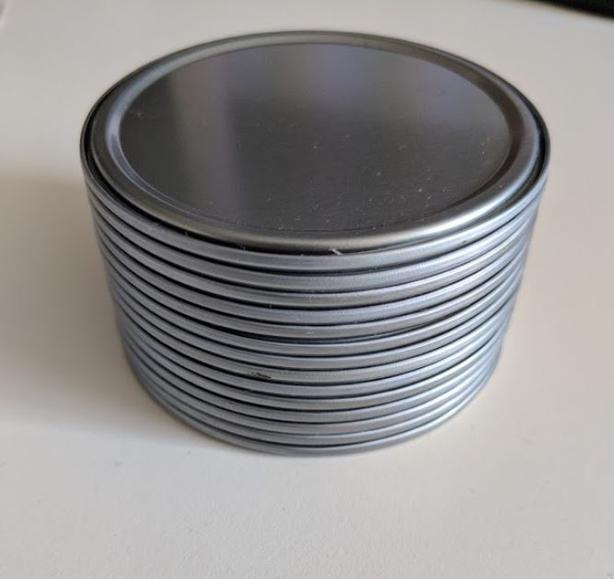 14 of juice can lids (washed)