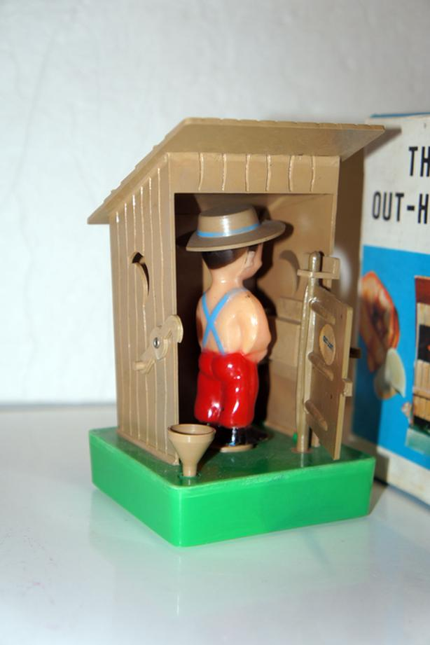 Vintage Novelty Man in Outhouse - Spins Around for a Surprise