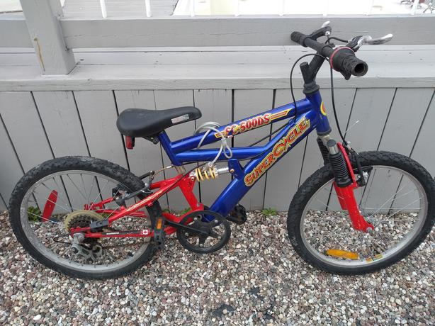 Super Cycle bicycle for kid,dual suspension and 5 speed.$70