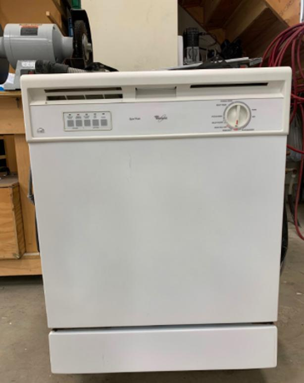 White Whirlpool Dishwasher under counter built-in