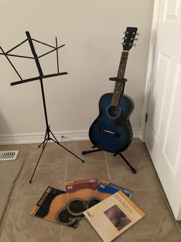 Junior guitar, guitar stand, book stand and 4 starter books