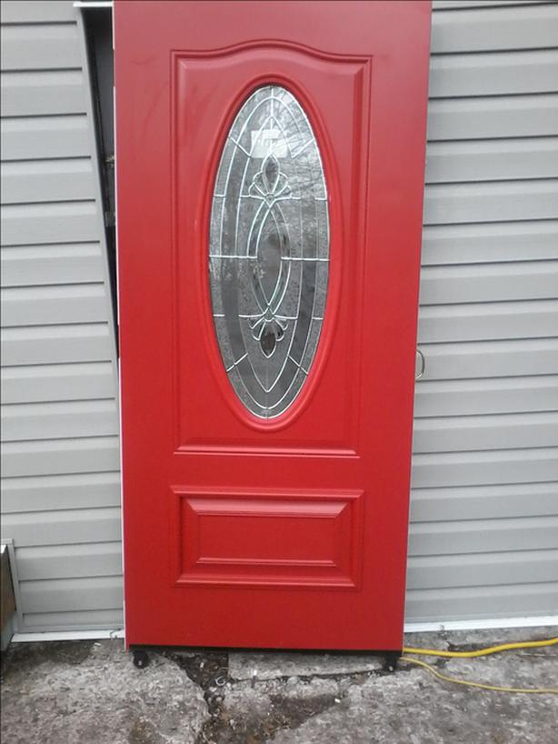 Over sized beautiful  Red door.  3 quarter light.