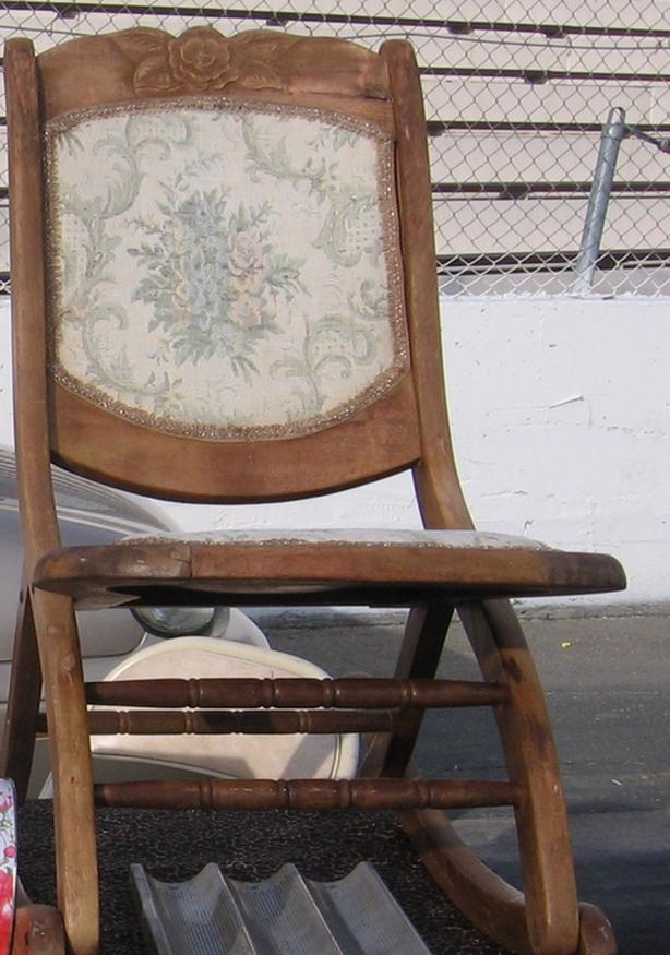 Vintage Child fold up rocking chair  leg damaged  $30.00