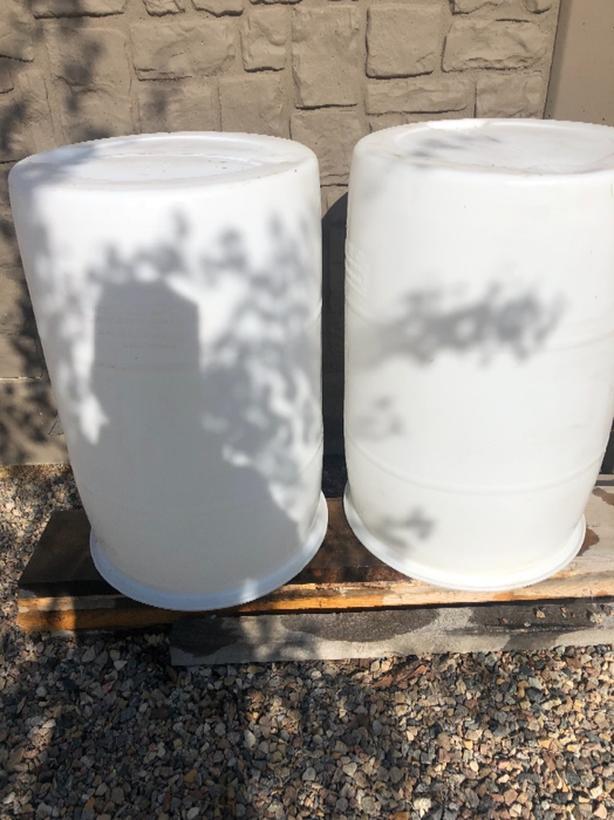2 plastic rain barrels