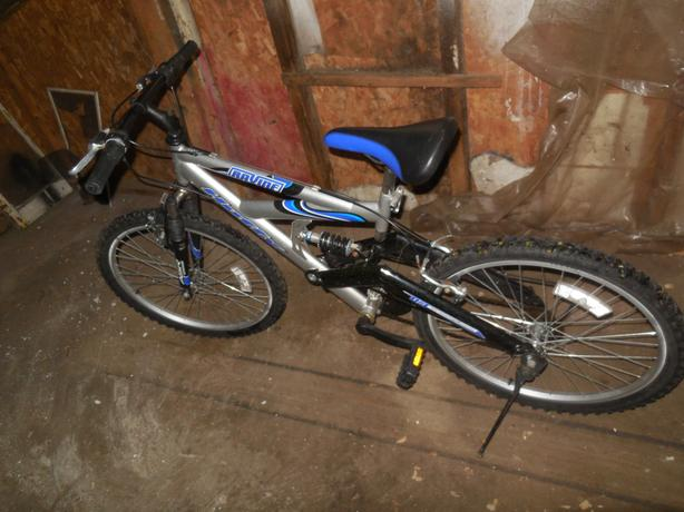 Blue and silver mountain bike