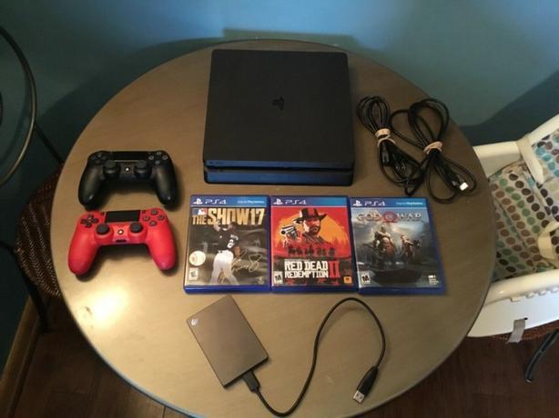 Sony PS4 Slim 500gb Console, External 1TB Memory + 3 Games