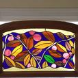 Stain glass in frame in blue with inset flowers