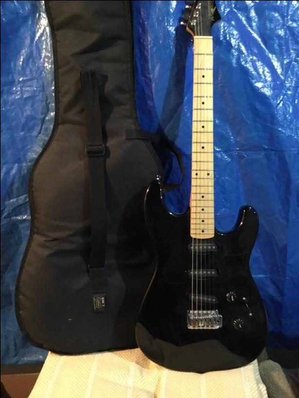 Renegade Electric Guitar with Travelling Case.