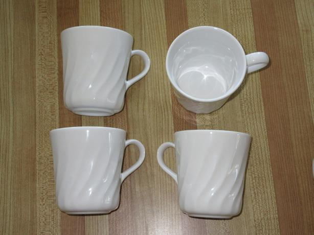4 white Corelle mugs - $3