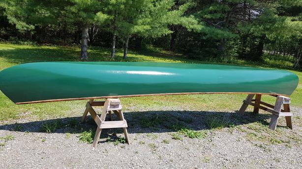 18 1/2 foot cedar strip, fiberglass,  wooden canoe
