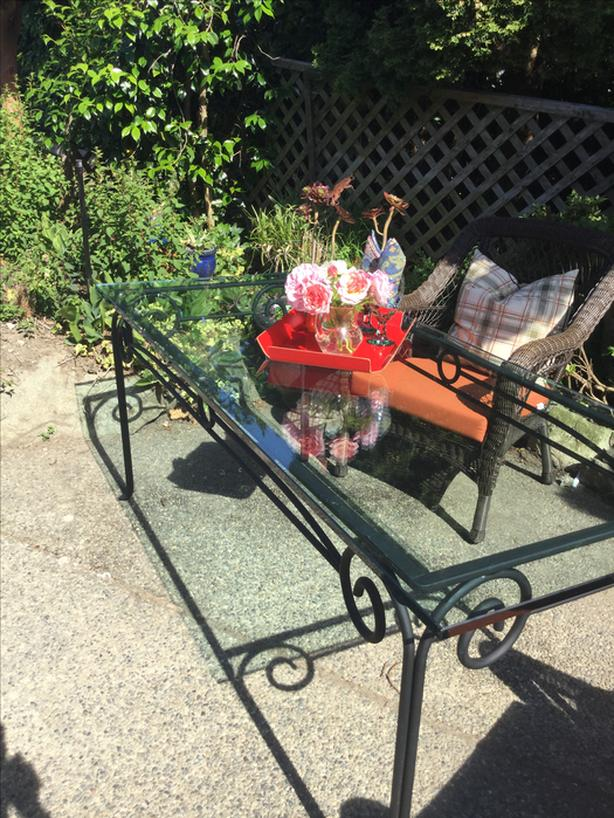 GLASS  AND  WROUGHT  IRON  PATIO  TABLE