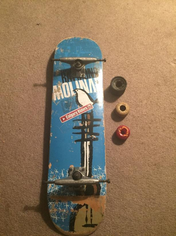 skateboard and 3 full sets of wheels