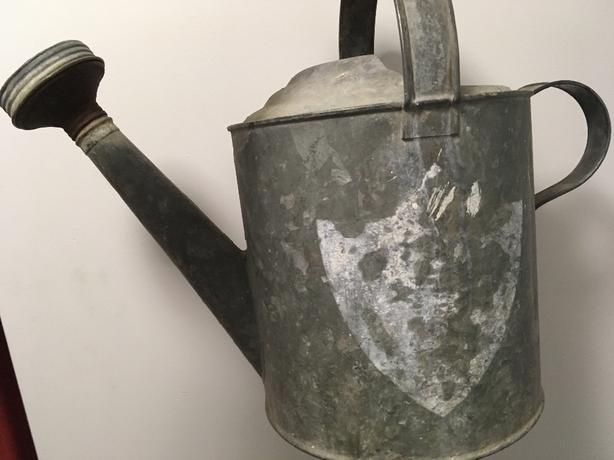 watering can , antique buckets
