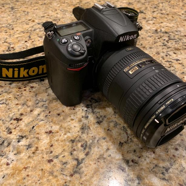 Nikon D7000 camera with 18-200 VR II and flash