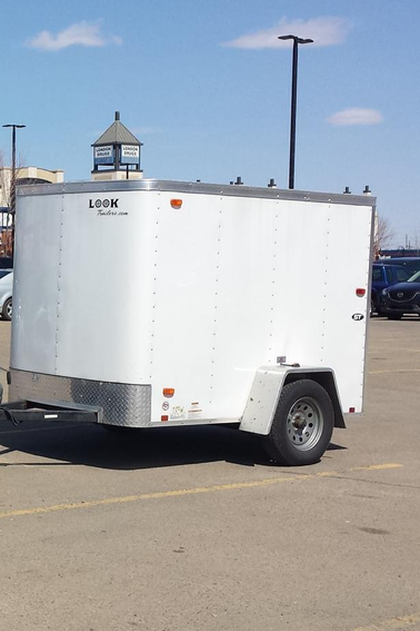 (5' X 8') Enclosed trailer LOOK