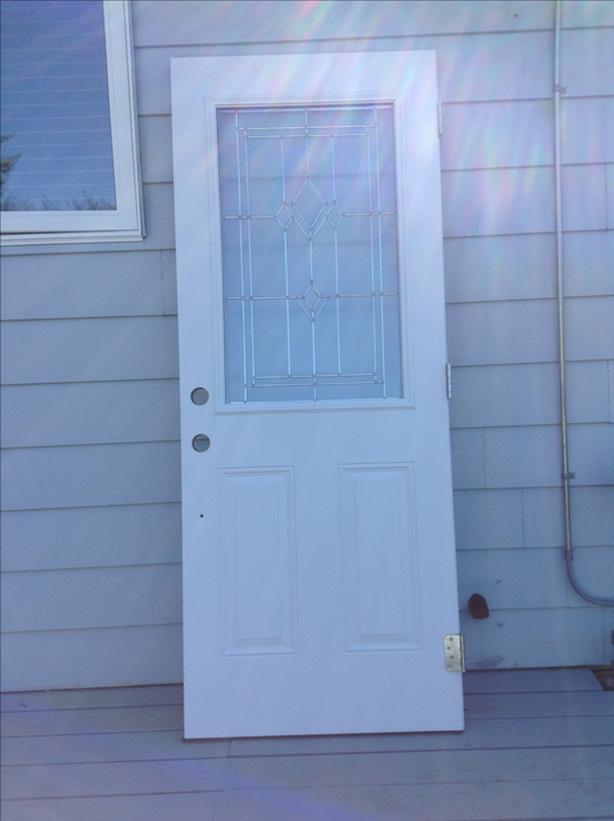 Exterior door with glass and full view storm door
