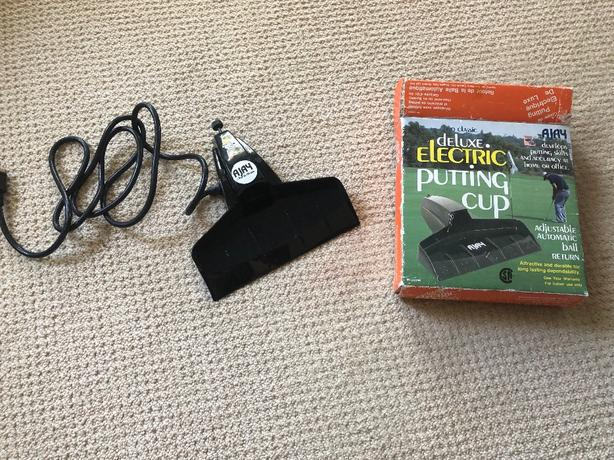 electric returning putting cup