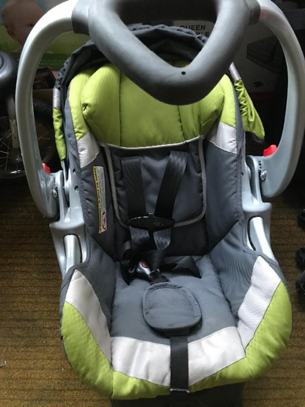 Baby Trend car seat with base.