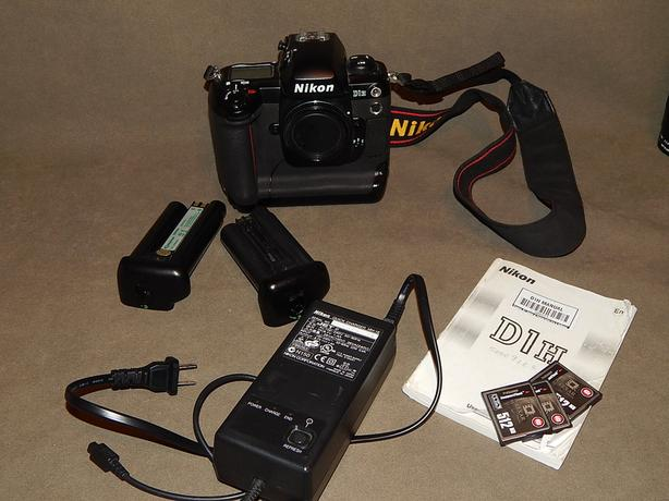 Nikon D1H DSLR Digital Camera with memory cards, charger and batteries