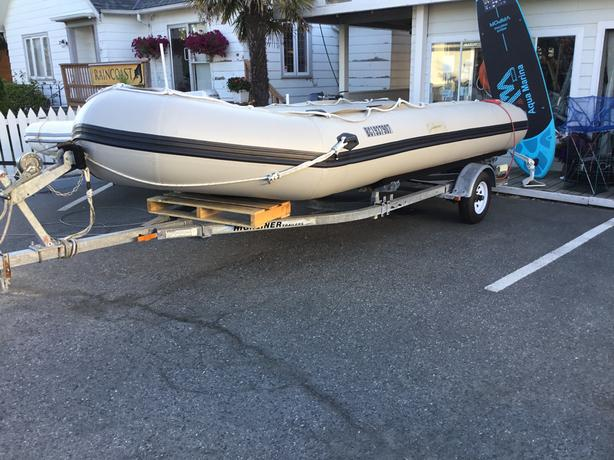 18' Delphin Soft Bottom Inflatable + Trailer