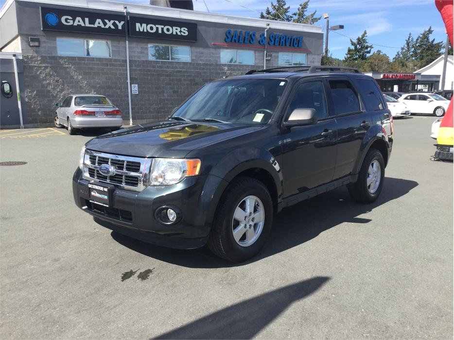 $7,995 · 2009 Ford Escape XLT- AUX AC Life Time *Free* Car Washes