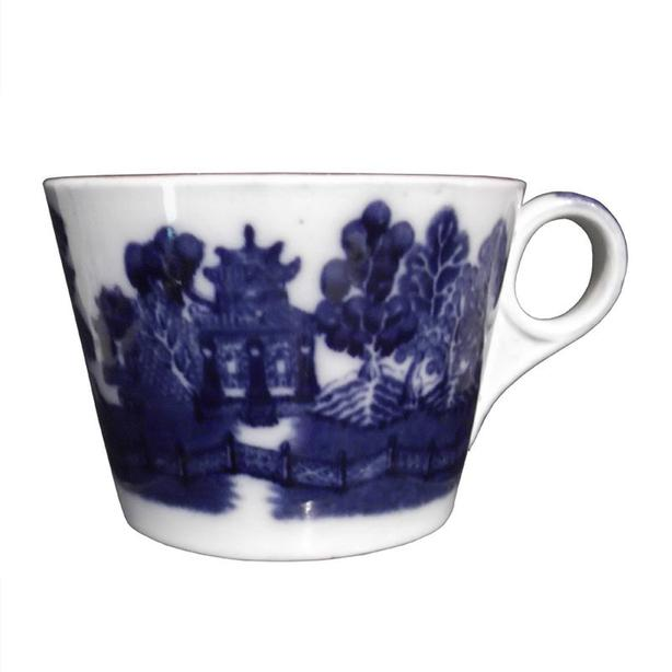 An Allan Line flow blue cup in the Willow pattern