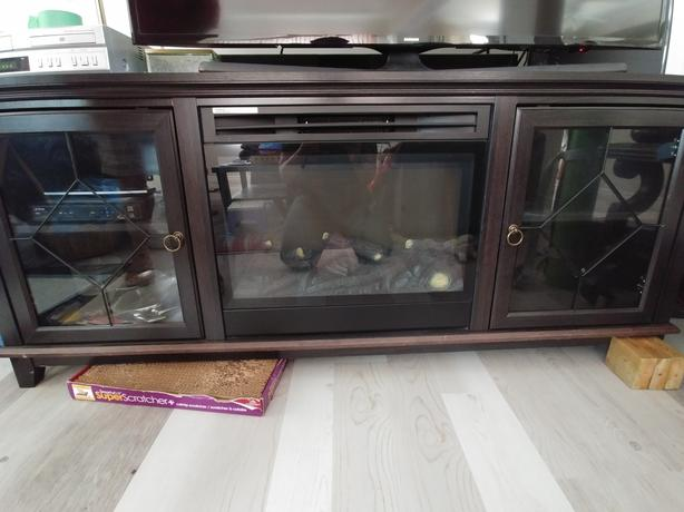TV stand with fireplace and storage
