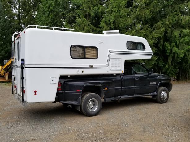 2000 dodge quad cab 4×4 / 11.5 foot  bigfoot light weight camper