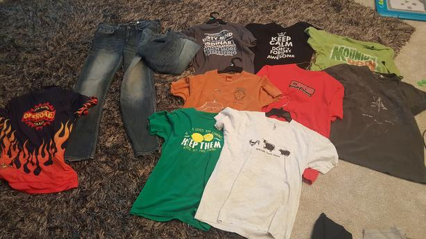 10 Tshirts, 2 pairs of jeans, 1 bicycle jersey (size Medium)