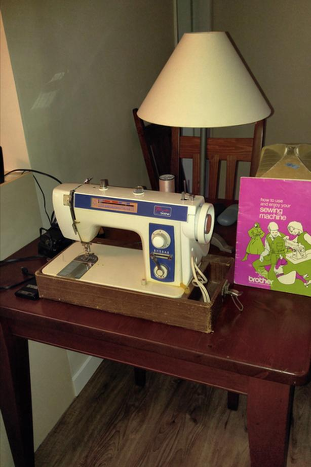 Singer sewing machine w/cabinet, Brother sewing machine