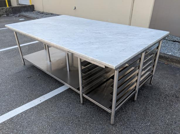 """54"""" x 96"""" Marble Top Welded Stainless Tables – 2 Available"""