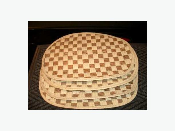 Placemats:  Set of 4 straw woven mats 17 inches by 12.5 inches