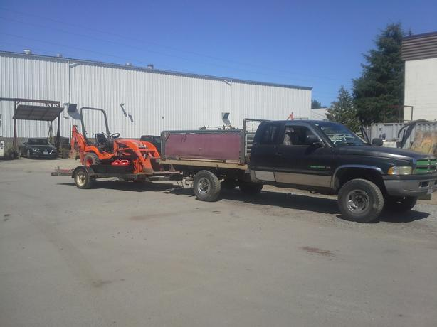 Backhoe with operator and attachments, post pounding, bush hog