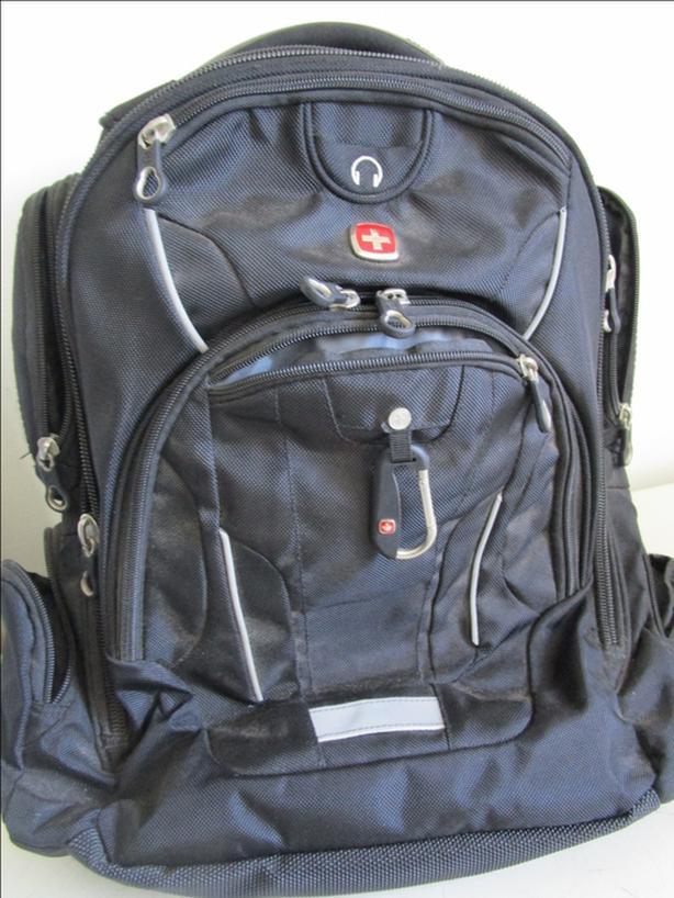 as new, backpack, has laptop space