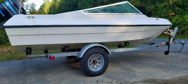 17ft. boat, 70hp. outboard and galvanized  trailer