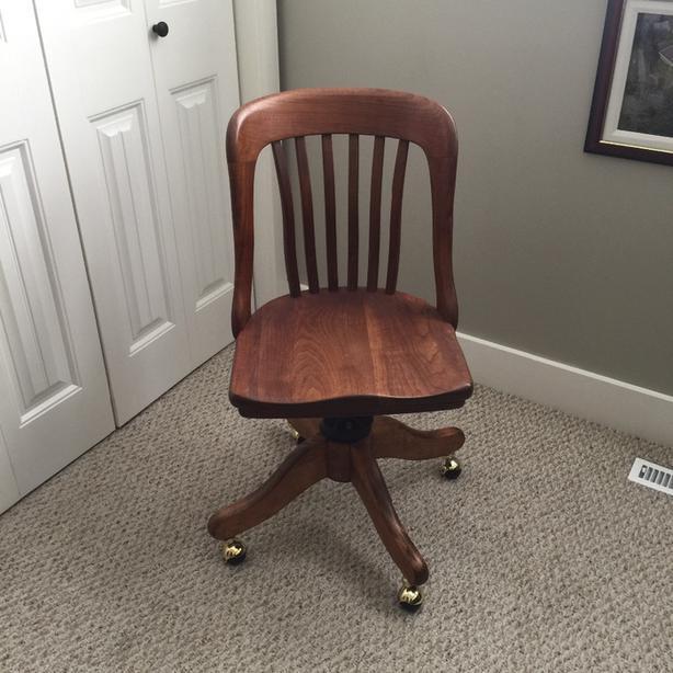 Oak swivel desk chair on wheels