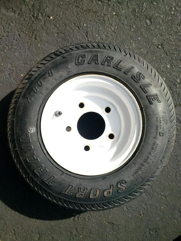 NEVER USED  - TRAILER TIRE  5 STUD.  4.80 X 8