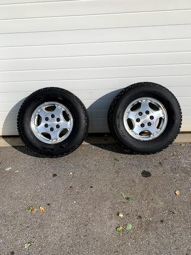 "2 winter tires 16"" c/w 6 bolt Chevy GMC Factory MagWheels"