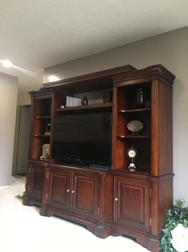 Large wood entertainment center