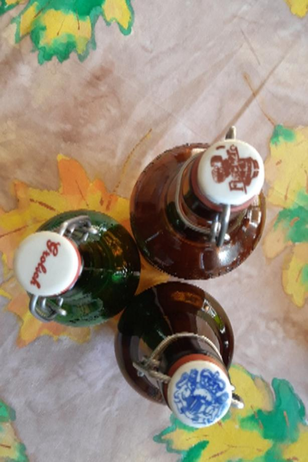 Vintage Stoat Beer bottles with toppers