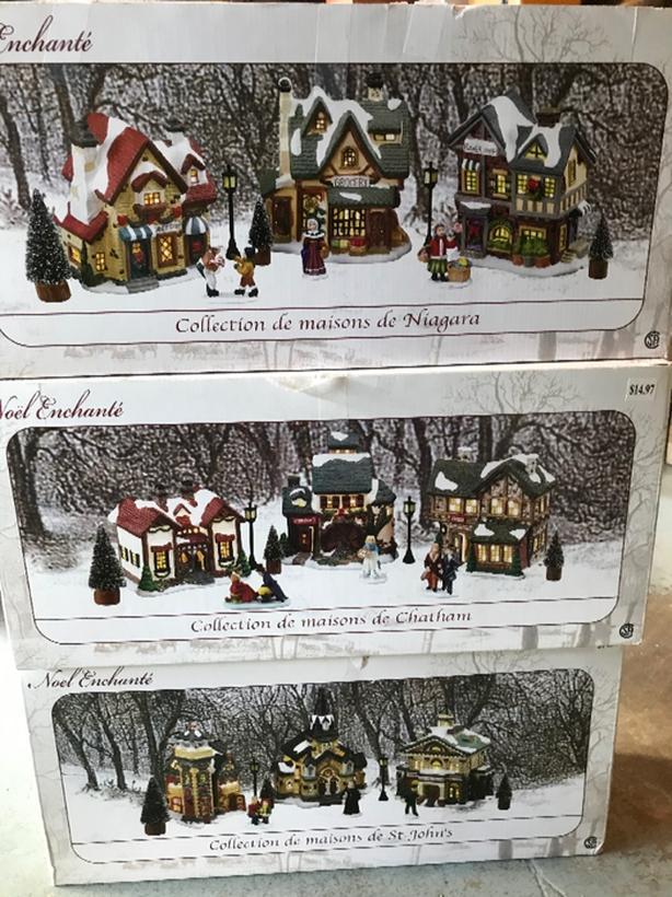 Nine Christmas village houses.