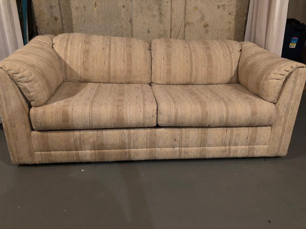 Double size beige sofa bed