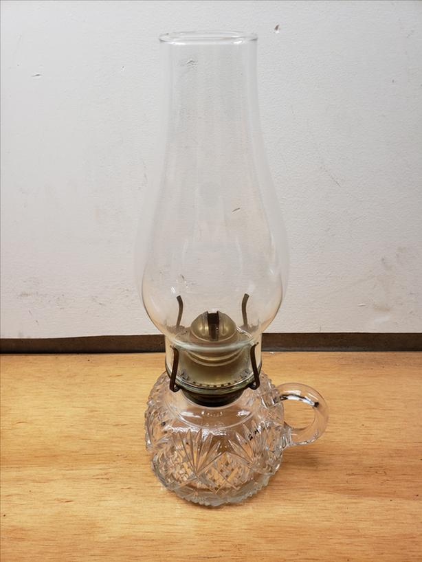 Antique crystal hurricane lamp.