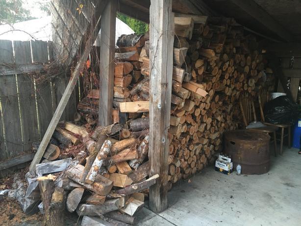 Firewood 1 cord on a flat driveway