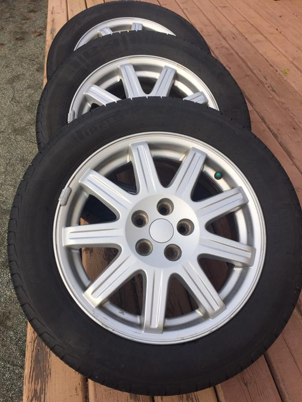 "4 Pirelli P4 all season Tires [85%] mounted on 16"" Alloy Mags $350."