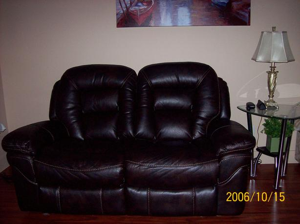 Near new love seat, leather back and seat, faux sides