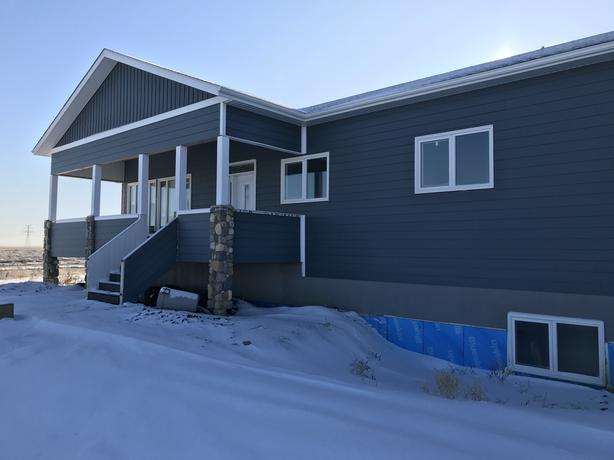 NEW 1680 SQFT BUNGALOW WITH TRIPLE GARAGE ON 10 ACRES JUST SOUTH OF CITY